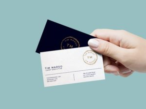 Female Hand holding Business Card Free Mockup