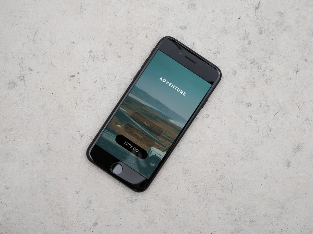 iPhone on Concrete Background free PSD