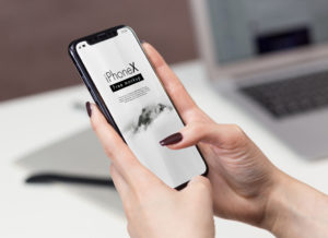 iPhone X in Office Set free PSD