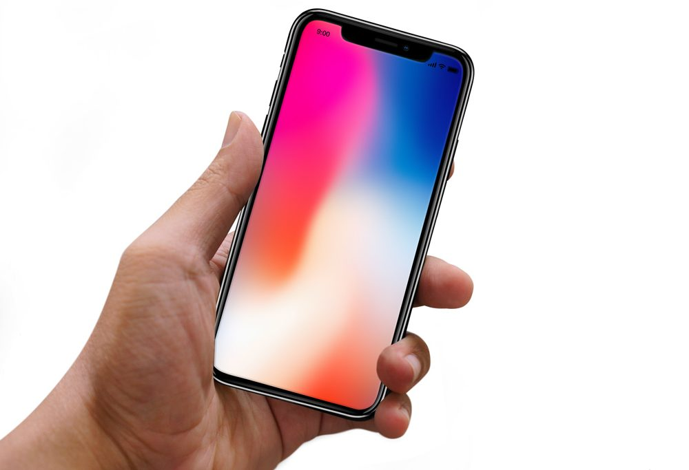 Male Hand holding iPhone X free PSD