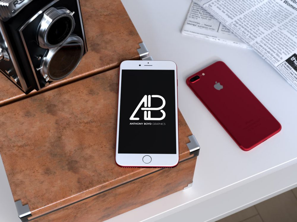 Red iPhone on Desk free PSD