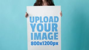 Woman holding Poster free PSD Mockup