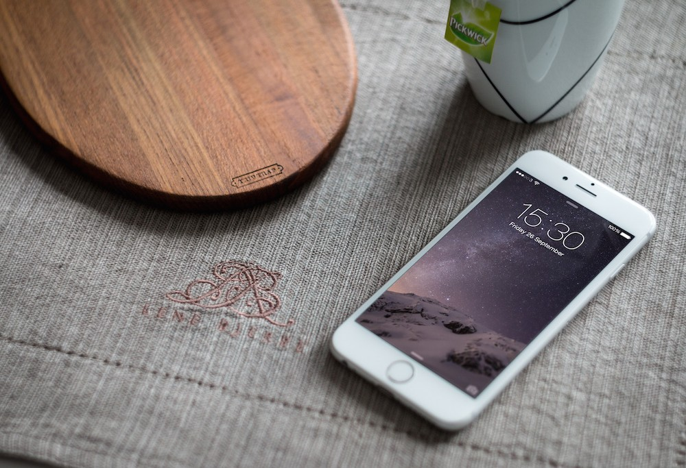 White iPhone 6 on Table Mockup