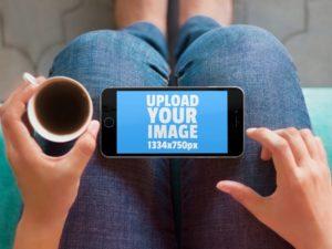 iPhone on Knees free PSD Mockup
