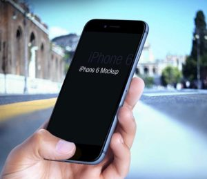 iPhone 6 in male Hand Mockup