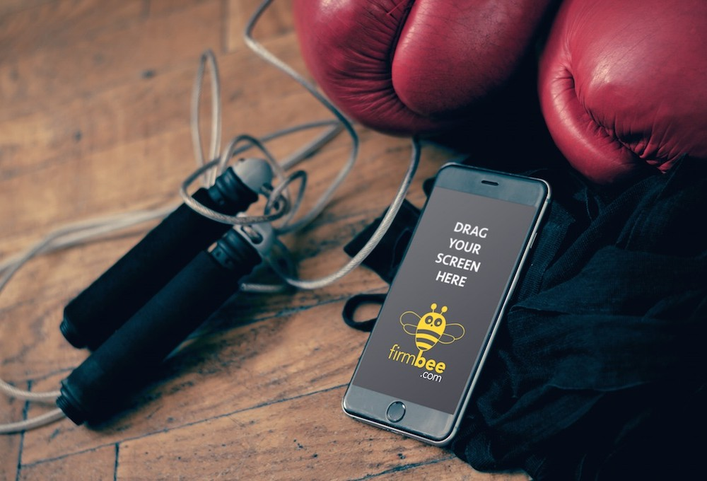 iPhone with Boxing Equipment Mockup