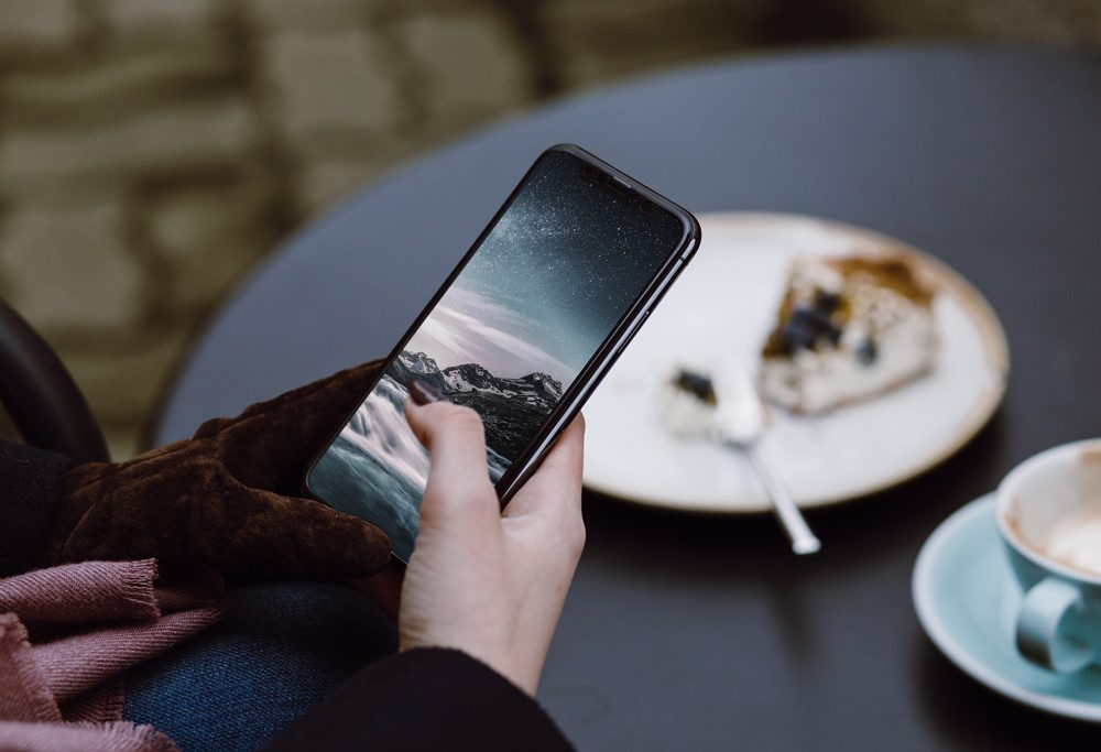 Holding iPhone X Outdoor Template