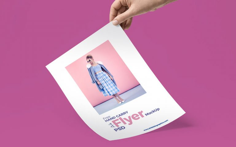 Flyer in A hand Mockup Free